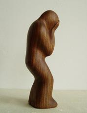 Holzfigur Leid